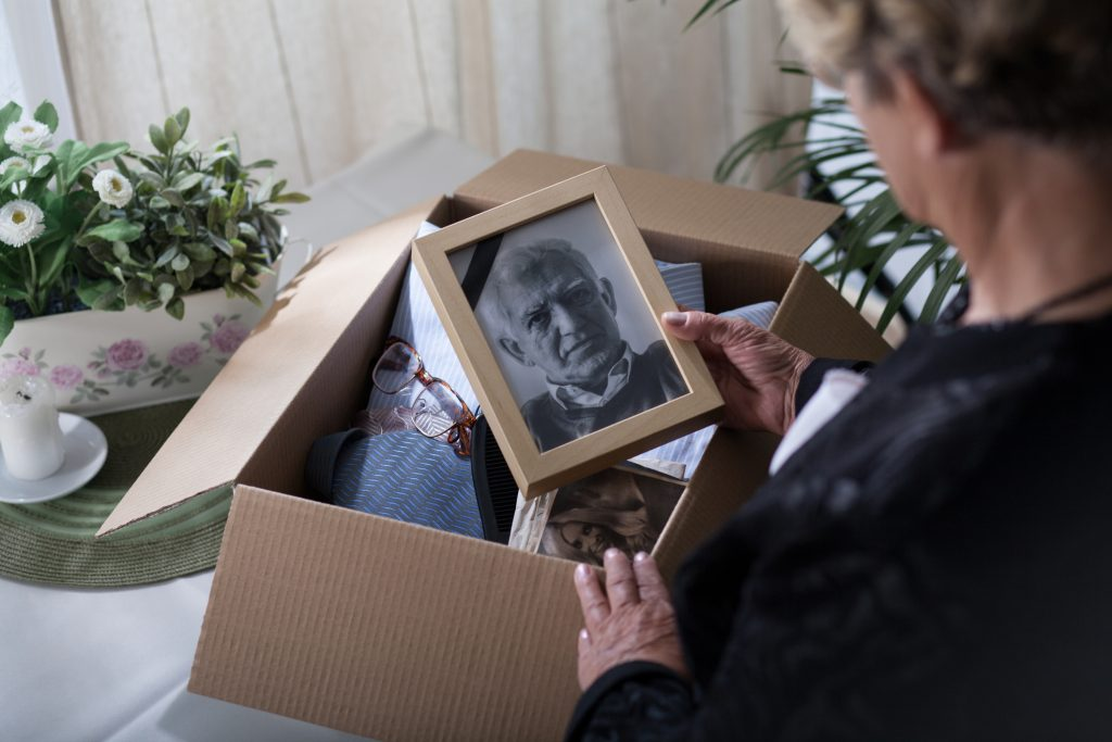 Woman packing personal items after the death of her husband