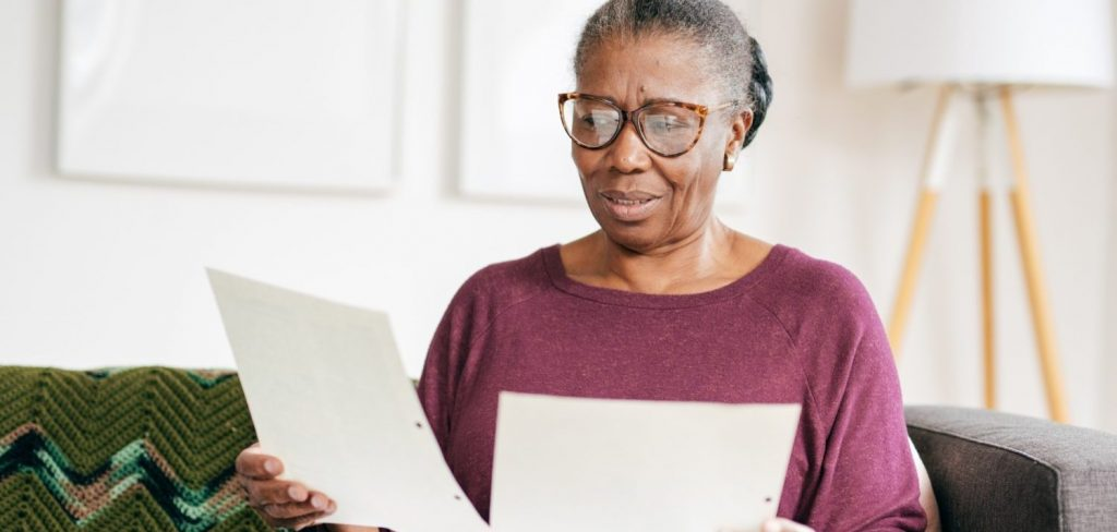 Woman Reviewing Papers After She's Inherited A House
