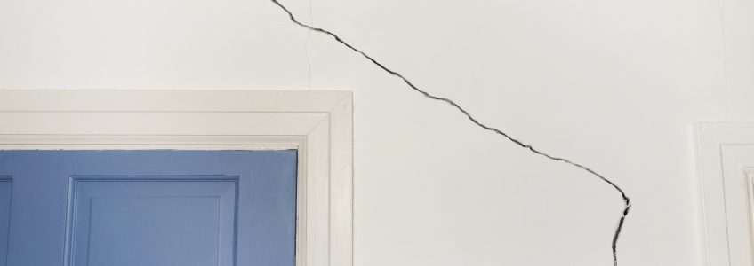 House with Structural Issues and Cracked Walls